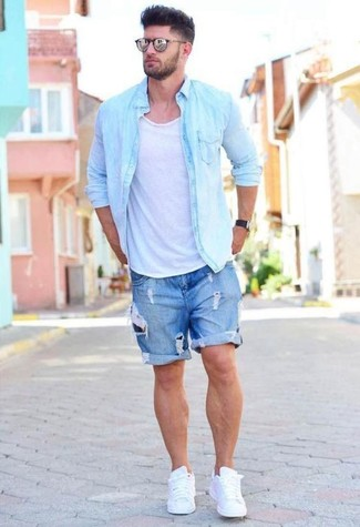 How to wear: white leather low top sneakers, blue ripped denim shorts, white tank, light blue denim shirt
