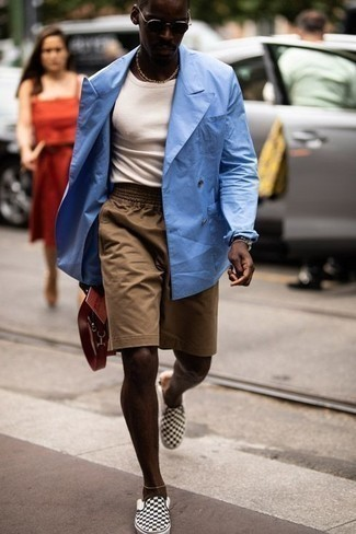 How to Wear Tan Shorts For Men: A light blue double breasted blazer and tan shorts are the perfect way to introduce some masculine refinement into your current repertoire. Black and white check canvas slip-on sneakers are an easy way to infuse a dash of stylish effortlessness into this ensemble.