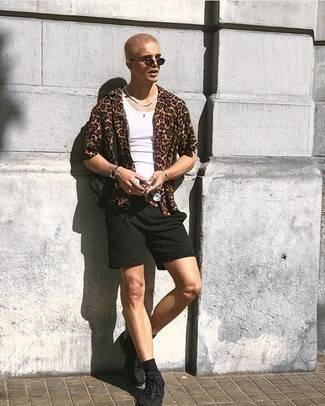 How to Wear Black Athletic Shoes For Men: A brown leopard short sleeve shirt and black shorts make for the ultimate laid-back style for today's gent. Up this outfit by slipping into black athletic shoes.