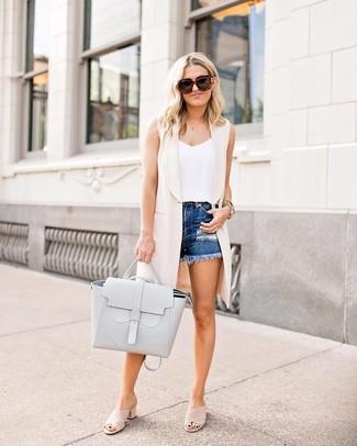 How to wear: beige suede mules, blue ripped denim shorts, white tank, beige sleeveless coat