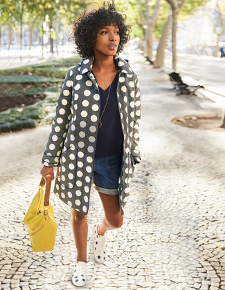 How to wear: white polka dot low top sneakers, blue denim shorts, navy v-neck sweater, grey polka dot coat