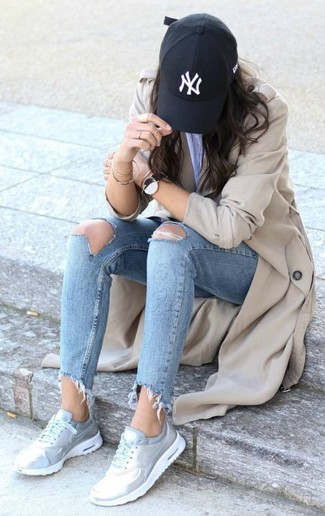 How to wear: black cap, silver athletic shoes, light blue ripped skinny jeans, beige trenchcoat