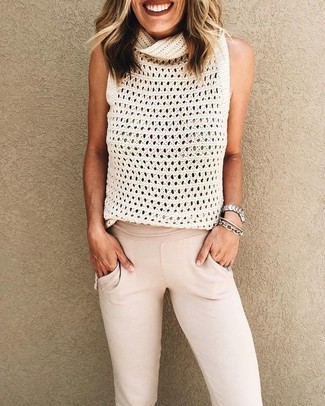 How to wear: silver watch, silver bracelet, beige sweatpants, white knit sleeveless top