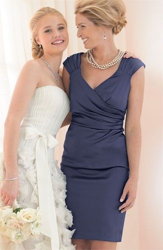 How to wear: silver earrings, beige pearl necklace, navy satin sheath dress