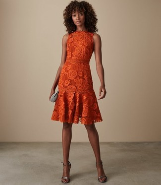 How to wear: silver embellished clutch, silver leather heeled sandals, orange lace fit and flare dress