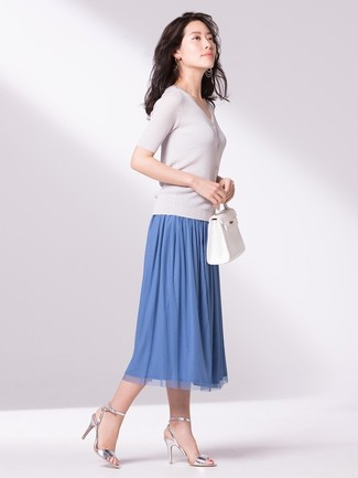 How to wear: white leather tote bag, silver leather heeled sandals, blue pleated midi skirt, white short sleeve sweater