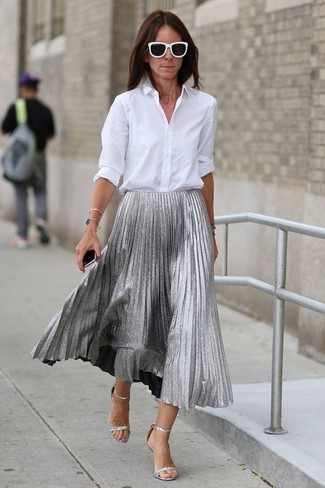 How to wear: black and white sunglasses, silver leather heeled sandals, silver pleated midi skirt, white dress shirt