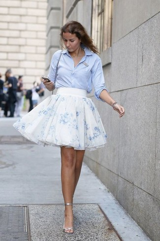 How to Wear a Light Blue Dress Shirt For Women: For something more on the off-duty side, marry a light blue dress shirt with a light blue floral chiffon full skirt. Introduce a pair of silver leather heeled sandals to the equation to tie the whole thing together.