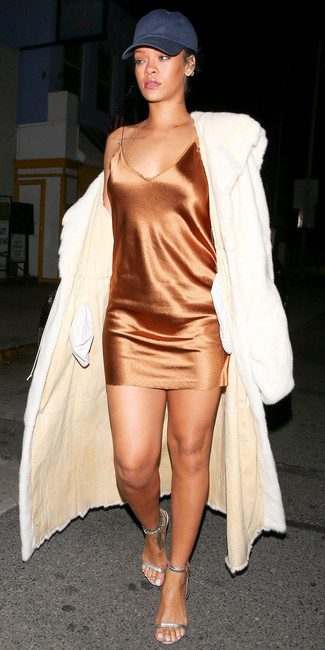 How to wear: silver leather heeled sandals, orange silk cami dress, white fur coat