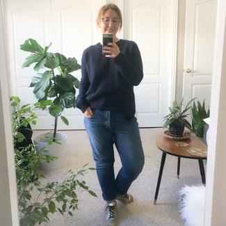 How to wear: silver leather low top sneakers, blue boyfriend jeans, navy crew-neck sweater