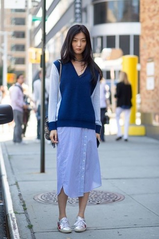 How to wear: silver leather low top sneakers, blue vertical striped shirtdress, navy v-neck sweater