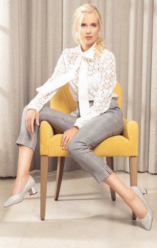 How to Wear a White Lace Long Sleeve Blouse: A white lace long sleeve blouse and grey plaid skinny pants are the kind of a foolproof casual outfit that you so awfully need when you have zero time to plan an ensemble. Complement your look with a pair of silver leather pumps and you're all set looking stunning.