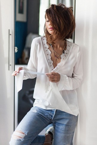 How to Wear a White Lace Long Sleeve Blouse: This casual pairing of a white lace long sleeve blouse and light blue ripped jeans is a safe option when you need to look stylish in a flash.