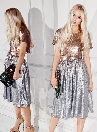 Nail glam in a silver sequin midi dress. Play down the casualness of your ensemble with gold leather heeled sandals. Totally summer-friendly, you can wear this getup all summer long.