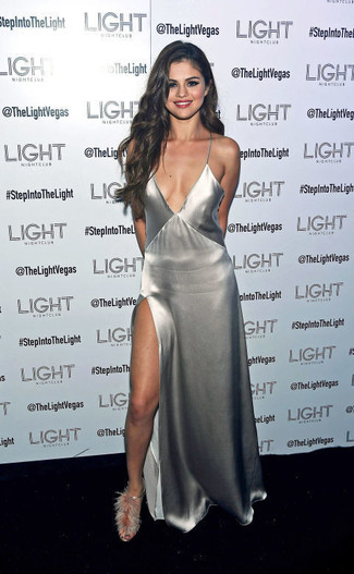 Selena Gomez wearing Silver Slit Maxi Dress, Grey Fur Heeled Sandals