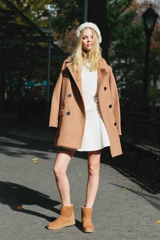 How to wear: tan uggs, white skater skirt, white cowl-neck sweater, camel coat