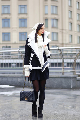How to wear: black suede lace-up flat boots, black skater skirt, white crew-neck sweater, black and white shearling jacket