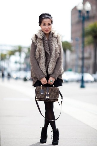 How to wear: black suede ankle boots, black skater skirt, grey knit open cardigan, grey fur vest