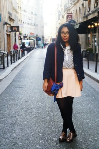 How to wear: dark brown leather oxford shoes, beige skater skirt, beige print short sleeve blouse, navy pea coat
