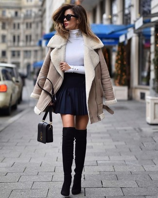 How to Wear a Gold Brooch: Wear a beige shearling jacket and a gold brooch to pull together an interesting and modern-looking relaxed casual ensemble. Our favorite of a great number of ways to finish off this look is black suede over the knee boots.