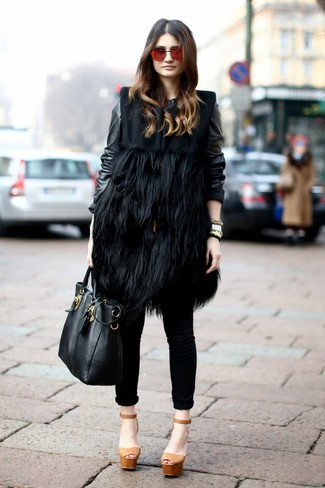 How to wear: tan chunky leather heeled sandals, black skinny jeans, black leather bomber jacket, black fur sleeveless coat