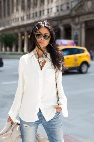 How to wear: black leather crossbody bag, light blue ripped skinny jeans, white chiffon button down blouse, beige blazer