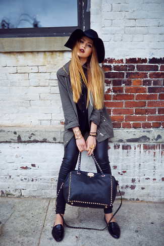 How to wear: black leather loafers, black leather skinny jeans, black chiffon button down blouse, charcoal fishtail parka