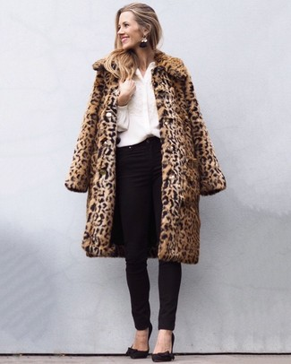How to wear: black suede pumps, black skinny jeans, white embroidered button down blouse, tan leopard fur coat