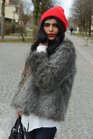 How to wear: black leather satchel bag, navy skinny jeans, white button down blouse, grey fur jacket