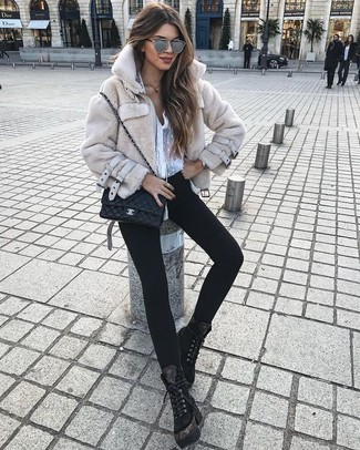 How to wear: black suede lace-up flat boots, black skinny jeans, white chiffon button down blouse, beige fur jacket