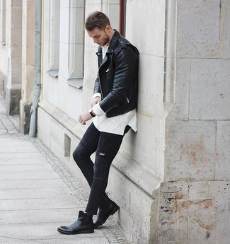 How to wear: black leather chelsea boots, black ripped skinny jeans, white cable sweater, black leather biker jacket