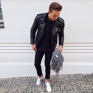 How to wear: white and black leather low top sneakers, black skinny jeans, navy cable sweater, black leather biker jacket