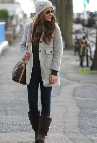 How to wear: dark brown uggs, navy skinny jeans, black cable sweater, grey coat