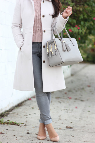 How to wear: beige leather pumps, grey skinny jeans, pink cable sweater, white coat