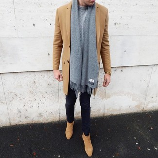 How to Wear Tan Suede Chelsea Boots For Men: Fashionable and comfortable, this off-duty combo of a camel overcoat and navy skinny jeans provides a multitude of styling possibilities. Complement your look with tan suede chelsea boots to effortlesslly dial up the style factor of any outfit.