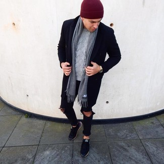 How to wear: black low top sneakers, black ripped skinny jeans, grey cable sweater, black overcoat