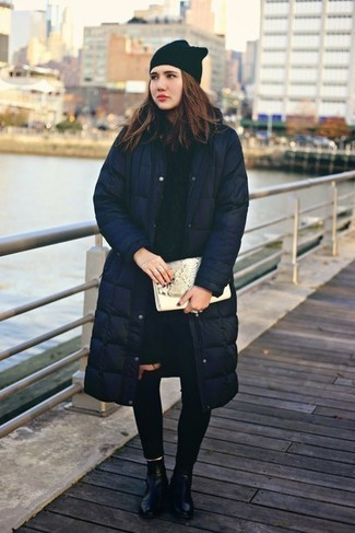 How to wear: black leather ankle boots, black ripped skinny jeans, navy cable sweater, navy puffer coat