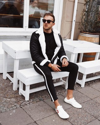How to wear: white leather low top sneakers, black and white skinny jeans, black cable sweater, black and white shearling jacket