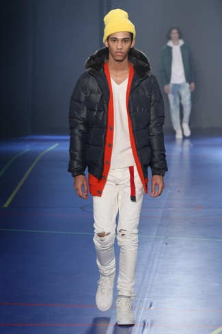 How to wear: white low top sneakers, white ripped skinny jeans, red cardigan, black puffer jacket