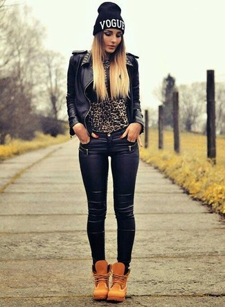 How to wear: tan nubuck lace-up flat boots, black leather skinny jeans, brown leopard crew-neck sweater, black studded leather biker jacket