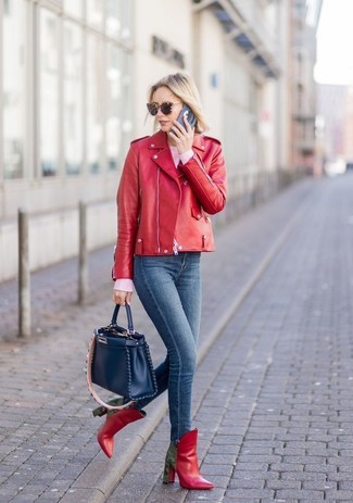 How to wear: red leather ankle boots, navy skinny jeans, pink crew-neck sweater, red leather biker jacket