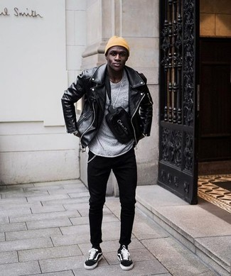 How to wear: black suede low top sneakers, black skinny jeans, grey crew-neck sweater, black leather biker jacket