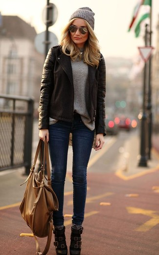 How to wear: dark brown leather ankle boots, navy skinny jeans, grey crew-neck sweater, dark brown leather biker jacket