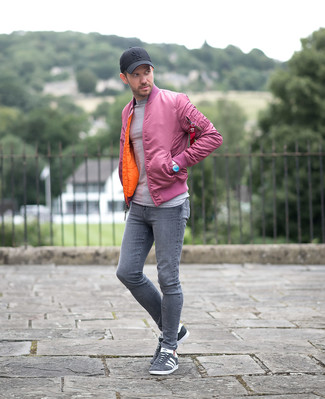 How to wear: grey suede low top sneakers, grey skinny jeans, grey crew-neck sweater, pink bomber jacket
