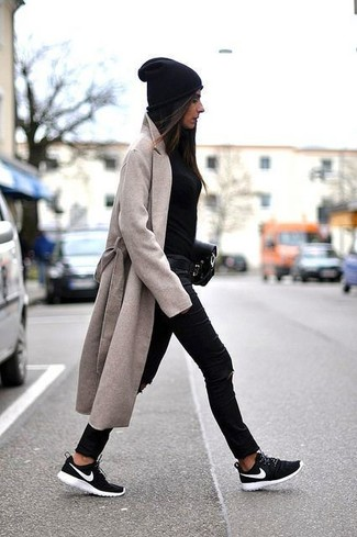 How to wear: black and white athletic shoes, black ripped skinny jeans, black crew-neck sweater, beige coat