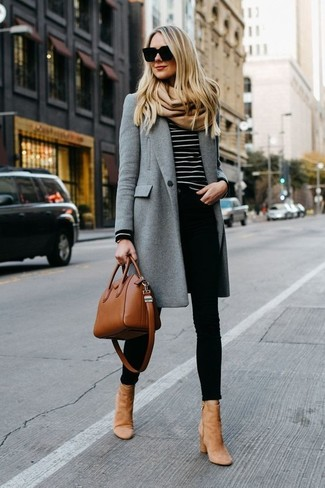 How to wear: tan suede ankle boots, black skinny jeans, black and white horizontal striped crew-neck sweater, grey coat