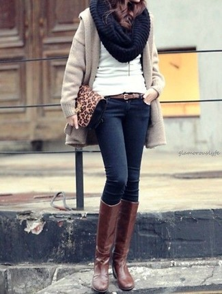 How to wear: brown leather knee high boots, navy skinny jeans, white crew-neck sweater, beige coat