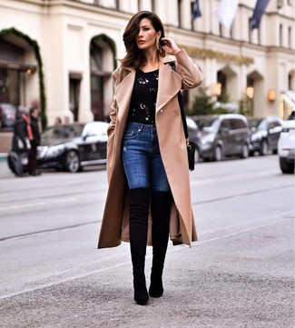 How to wear: black suede over the knee boots, blue skinny jeans, black embellished crew-neck sweater, camel coat