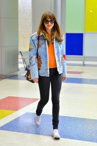 How to wear: white canvas high top sneakers, black skinny jeans, orange crew-neck sweater, light blue embroidered denim jacket