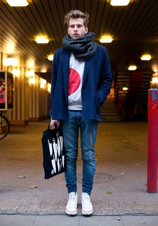How to wear: white low top sneakers, blue skinny jeans, white and red print crew-neck sweater, navy double breasted blazer